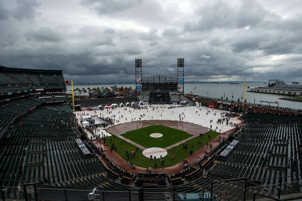 Stormy weather doesn't stop fans as they enjoy the Giants' FanFest at the ballpark event at Oracle Park in San Francisco on February 09, 2019. In spite of rainy weather, fans arrived in force to meet players and get their paraphernalia autographed.