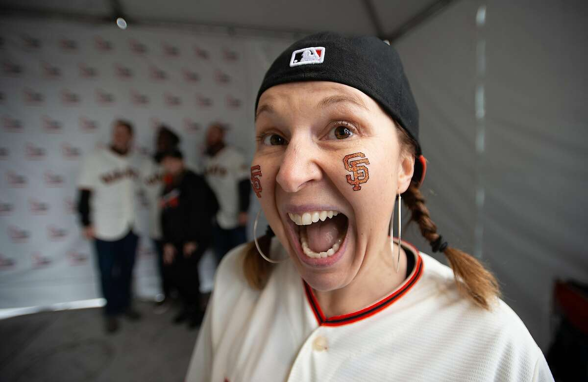 Patricia Ferrant reacts after meeting players during the Giants' FanFest at the ballpark event at Oracle Park in San Francisco on February 09, 2019. In spite of rainy weather, fans arrived in force to meet players and get their paraphernalia autographed.