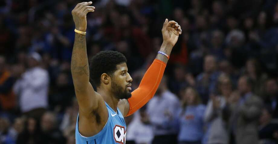 PHOTOS: Rockets game-by-game Oklahoma City Thunder forward Paul George gestures to the crowd after a basket during the second half of the team's NBA basketball game against the Orlando Magic in Oklahoma City, Tuesday, Feb. 5, 2019. (AP Photo/Sue Ogrocki) Browse through the photos to see how the Rockets have fared in each game this season. Photo: Sue Ogrocki/Associated Press