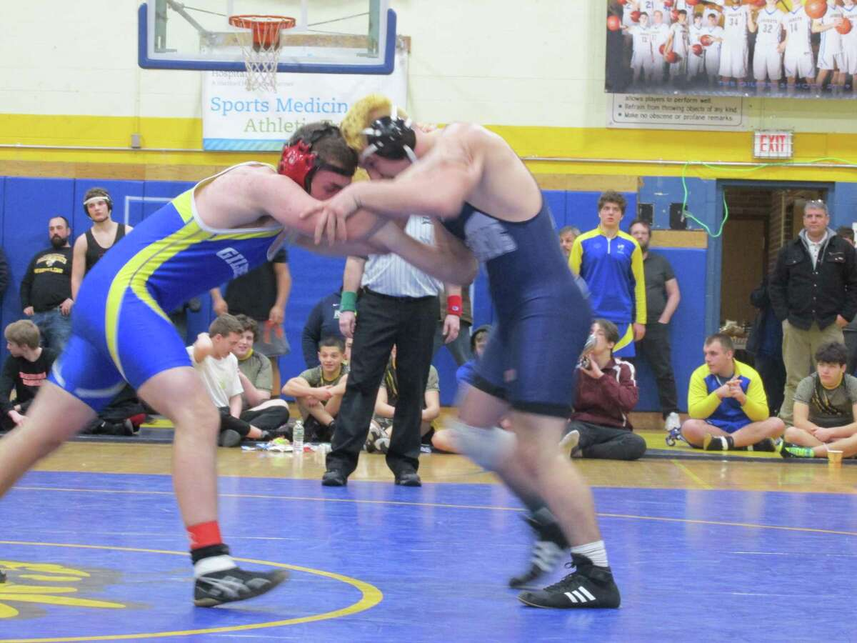 Gilbert's Alex Smith, left, won a close decision over Nonnewaug's Flori Cenkolli on the way to a second-straight Yellowjacket team championship in the Berkshire-Valley Postseason Invitational Saturday at The Gilbert School.