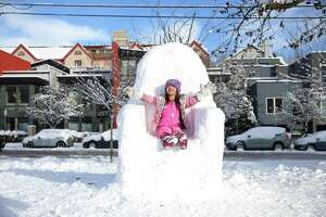 Aria Chen, 6, declares herself Queen in a snow Iron Throne as Seattlites enjoy the fresh snow at Cal Anderson Park after the city got up to eight inches in some areas over Friday night and Saturday, Jan. 9, 2019.