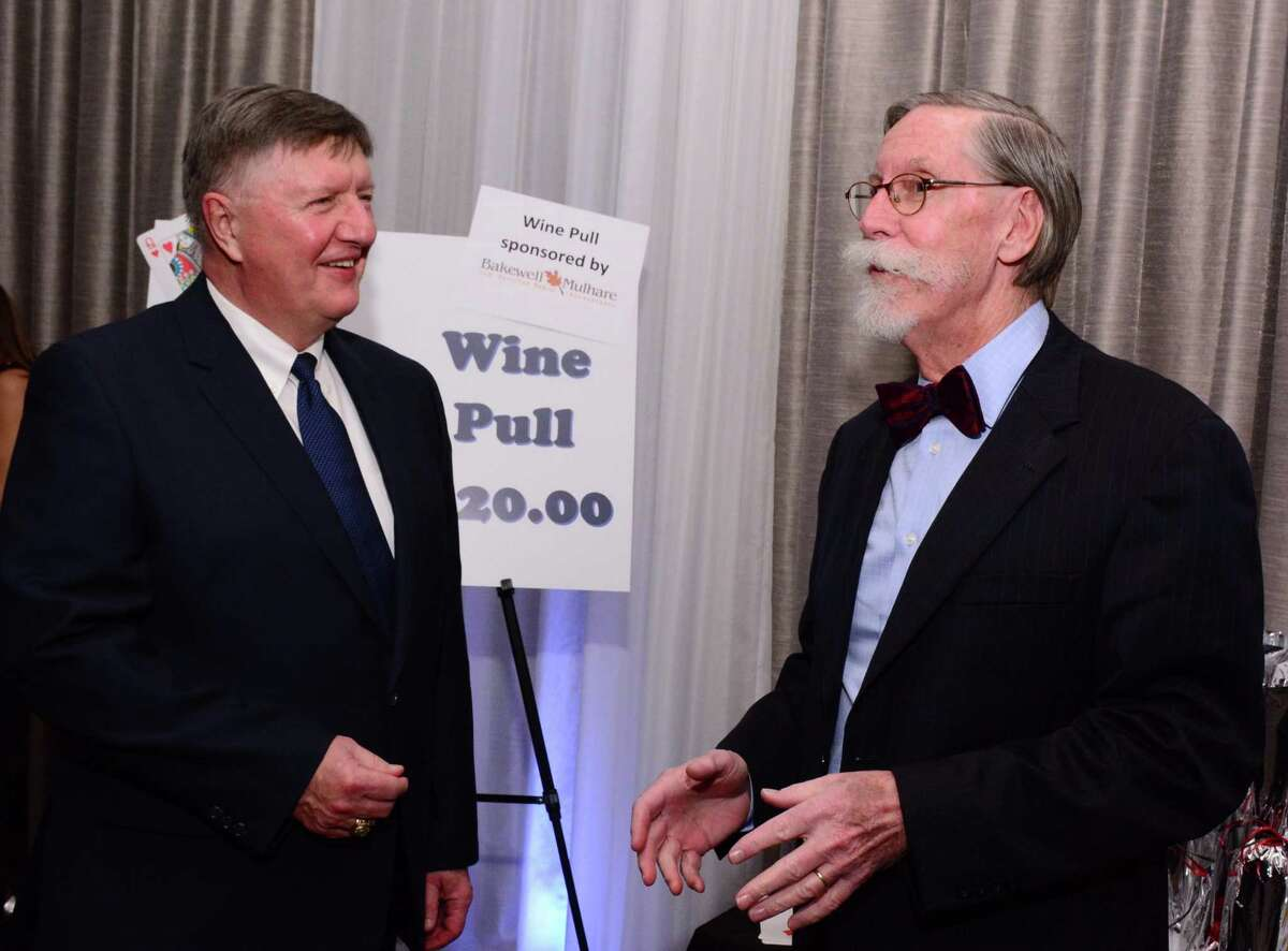 Gary Passineau and Bob O'Keefe man the Wine Pull station during The Greater New Milford Chamber of Commerce 21st annual Crystal Winter Gala on Saturday February 9, 2019 at the Amber Room Colonnade in Danbury.