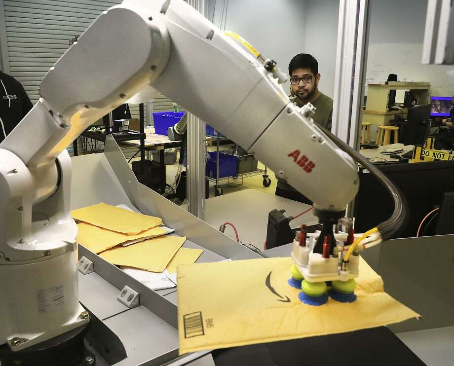 Abhijit Majumdar, AI/vision developer at Plus One Robotics, demonstrates the PickOne, a Swiss-made robot that sorts out cluttered packages, which uses software developed by Plus One. Photo: Bob Owen / Hearst Newspapers / ©2019 San Antonio Express-News