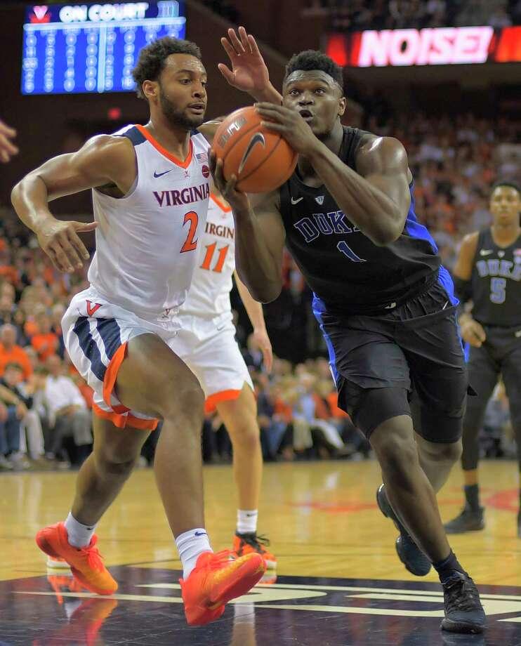 1bd646c012ee Duke forward Zion Williamson (1) drives to the basket against Virginia  guard Braxton Key