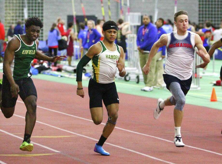 "Hamden's Christopher Pigatt, center, competes in the 55 meter dash during CIAC 'Class LL"" Track Championship action in New Haven, Conn., on Saturday Feb. 9, 2019. Pigatt won the race. At left is Enfield's Joel Stewart and at right is McMahon's Korey Morton. Photo: Christian Abraham / Hearst Connecticut Media / Connecticut Post"