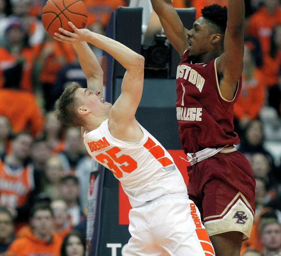 Syracuse's Buddy Boeheim, left, tries to shoot over Boston College's Jarius Hamilton, right, during the second half of an NCAA college basketball game in Syracuse, N.Y., Saturday, Feb. 9, 2019. Syracuse won 67-56. (AP Photo/Nick Lisi) Photo: Nick Lisi / Copyright 2019 The Associated Press. All rights reserved.
