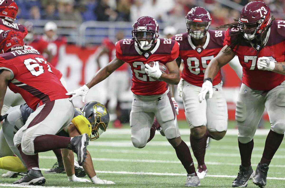 Aaron Green gathers blockers on a run up the middle for San Antonio as the Commanders host San Diego at the Alamodome in the opening game for the Alliance of American Football league on February 9, 2019.