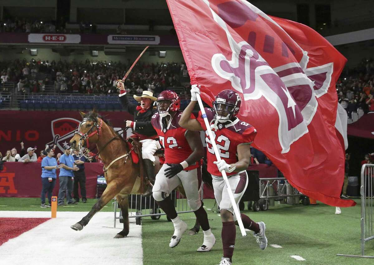 Col. Travis on horseback helps the players charge out onto the field as the Commanders host San Diego at the Alamodome in the opening game for the Alliance of American Football league.