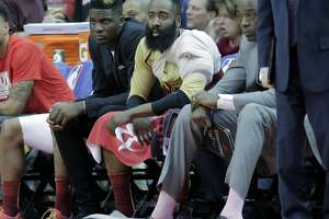 Houston Rockets guard James Harden (13) and center Clint Capela (15) watch as the Oklahoma City Thunder make a comeback in the third quarter at the Toyota Center on Saturday, Feb. 9, 2019 in Houston. Houston Rockets lost the game 117-112.