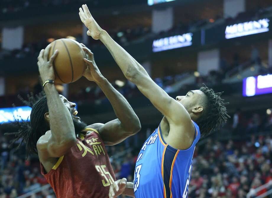 Houston Rockets forward Kenneth Faried (35) puts up a shot over Oklahoma City Thunder guard Terrance Ferguson (23) in the second half at the Toyota Center on Friday, Feb. 9, 2018 in Houston. Houston Rockets lost the game 117-112. Photo: Elizabeth Conley/Staff Photographer