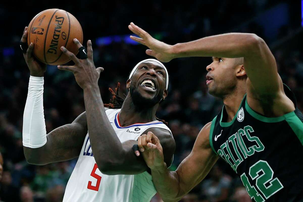 Los Angeles Clippers' Montrezl Harrell (5) shoots against Boston Celtics' Al Horford (42) during the second half of an NBA basketball game in Boston, Saturday, Feb. 9, 2019. (AP Photo/Michael Dwyer)