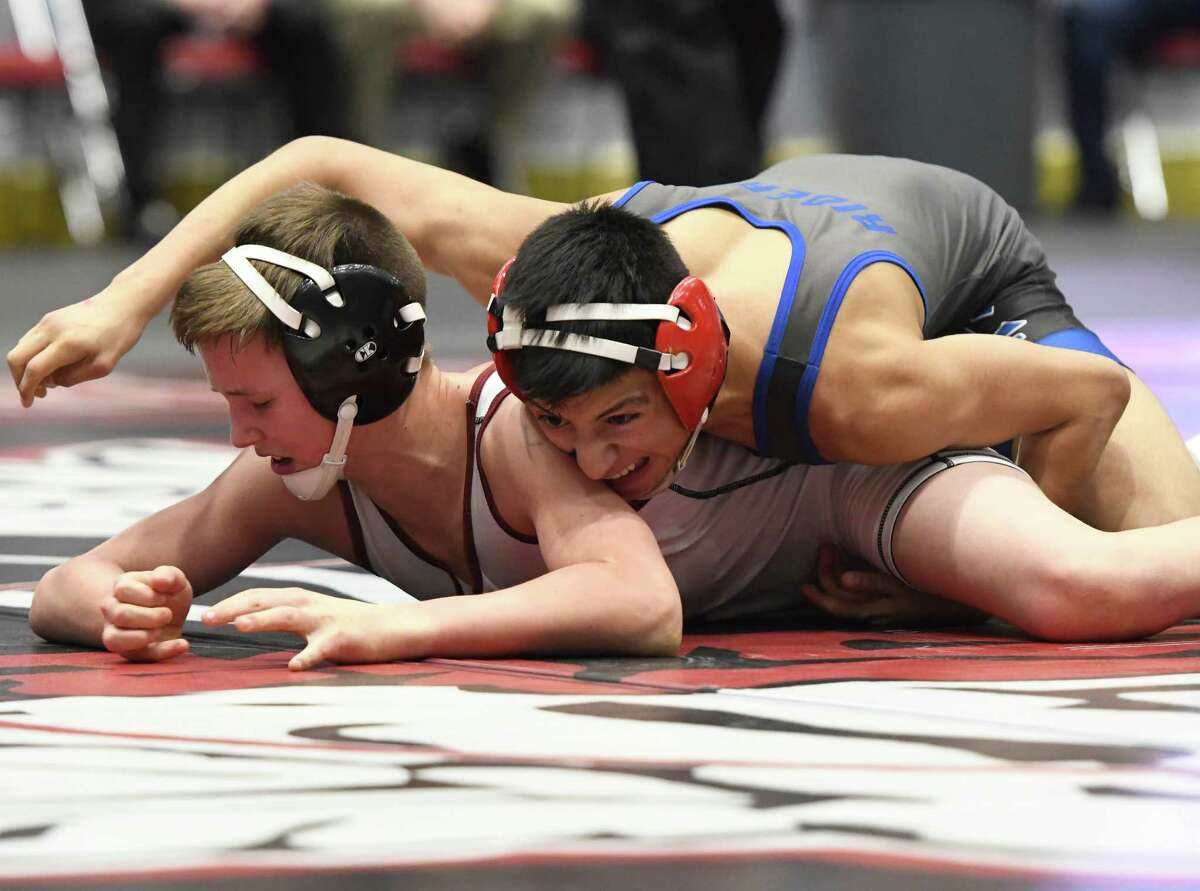 Ichabod Crane's Jair Gomez wrestles Greenville's Kieran Cullen in the division II 99-lb. weight class final of the Section II wrestling championships at Cool Insuring Arena in Glens Falls, N.Y., on Saturday, Feb. 9, 2018. (Jenn March, Special to the Times Union )