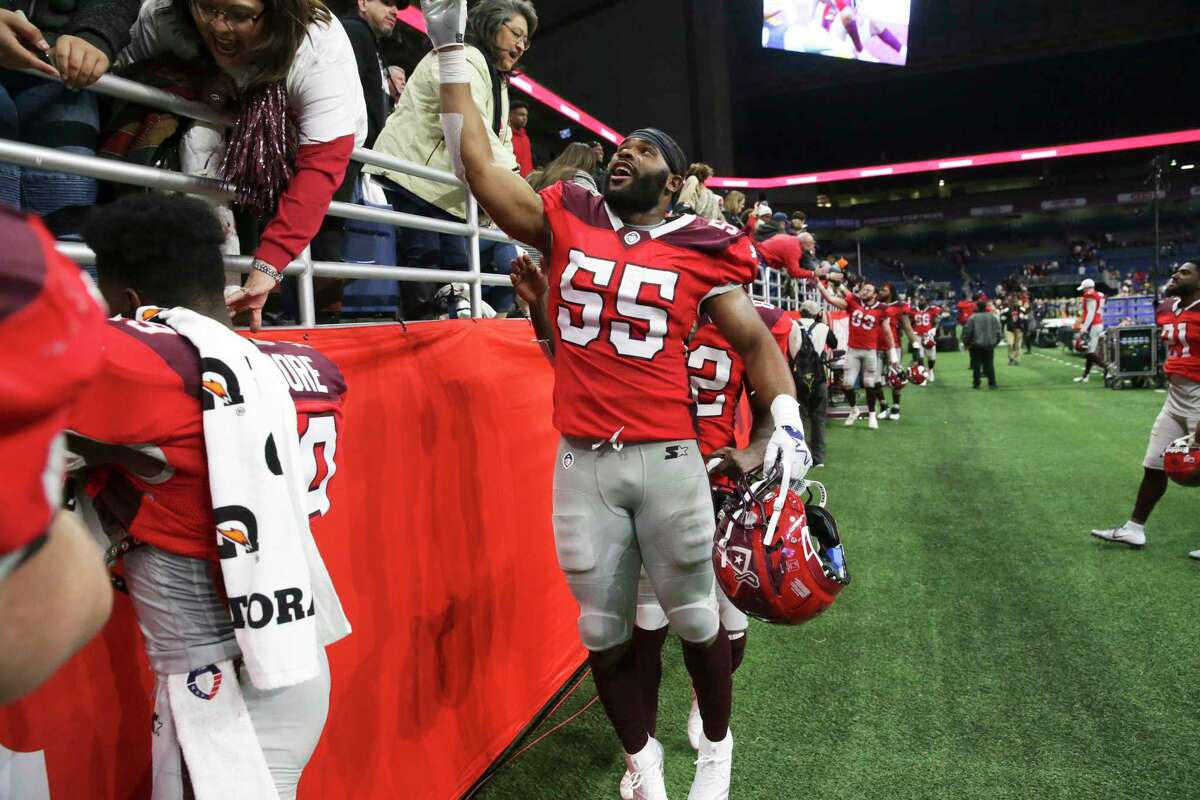 Nick Temple jumps up to high-five San Antonio fans after the Commanders host San Diego at the Alamodome in the opening game for the Alliance of American Football league on Feb. 9, 2019.