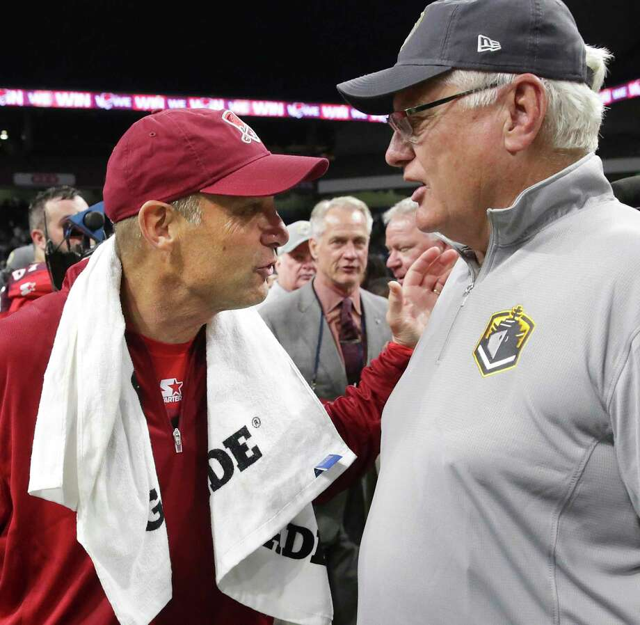SanAntonio coach Mike Riley meets Fleet coach Mike Martz after the game as the Commanders host San Diego at the Alamodome in the opening game for the Alliance of American Football league on February 9, 2019. Photo: Tom Reel, Staff / Staff Photographer / 2019 SAN ANTONIO EXPRESS-NEWS