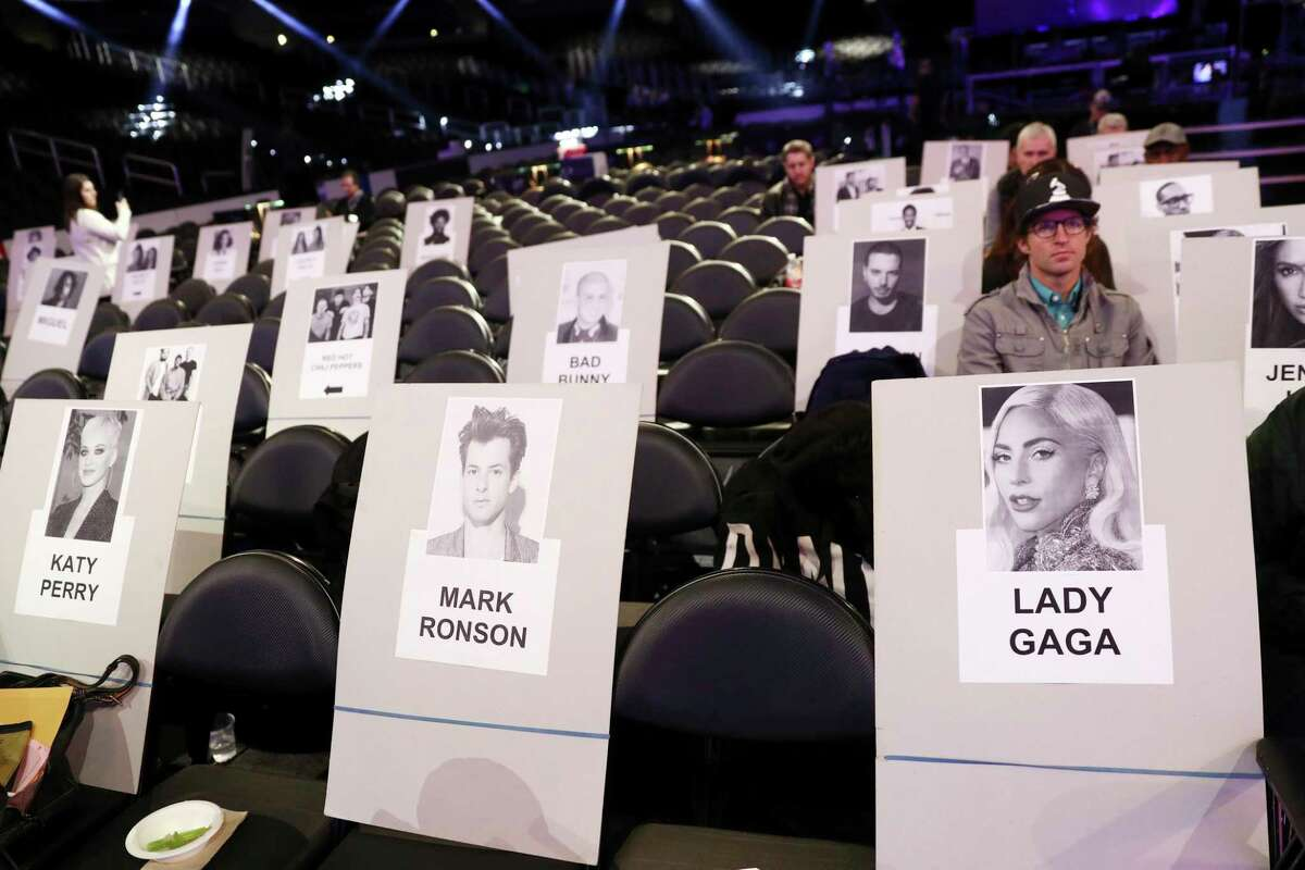 Seating placards appear for Grammy nominees Mark Ronson and Lady Gaga for the 61st annual Grammy Awards on Thursday, Feb. 7, 2019, in Los Angeles. The 61st Grammy Awards will be held on Sunday. (Photo by Matt Sayles/Invision/AP)