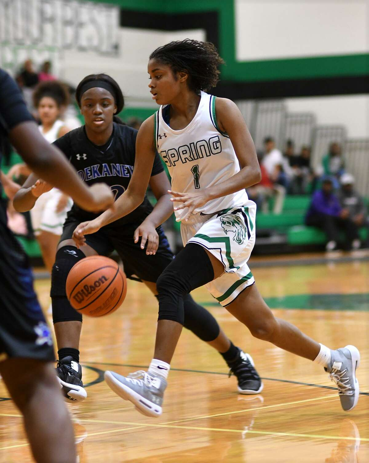 Spring senior guard Kaitlyn Davis (1) drives with the ball against Dekaney senior guard Amanda Ferry, left, during their District 16-6A matchup at Spring High School on Jan. 4, 2019.