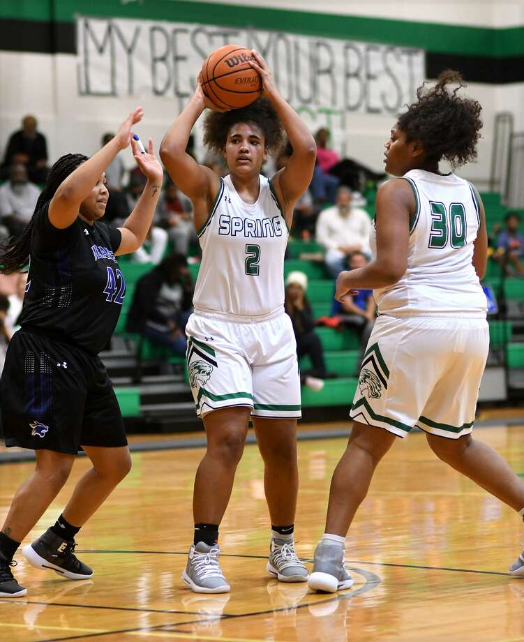 Spring senior forward Haley Wesley (2) works the ball between Dekaney senior forward Faith Roberts (42) and teammate and junior power forward Jade McAlister (30) during their District 16-6A matchup at Spring High School on Jan. 4, 2019. Photo: Jerry Baker, Houston Chronicle / Contributor / Houston Chronicle