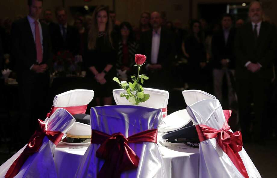 Attendants stand in honor of the hats of all five of the US military services placed on the plates of an empty table in the center of the room for the Missing Man Table and Honors Ceremony during the Salute to Our Heroes gala at the Omni Houston Hotel Saturday, Feb. 9, 2019 in Houston, TX. Photo: Michael Wyke, Houston Chronicle / Contributor / © 2019 Houston Chronicle
