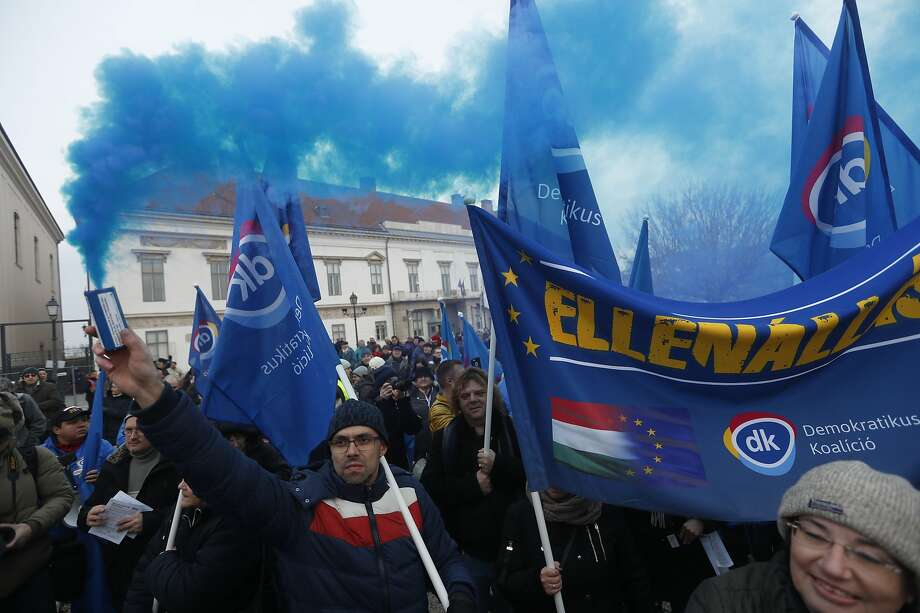 """Demonstrators rally in Budapest to protest the policies of Prime Minister Viktor Orban. The new initiative on population, Orban said, """"is the Hungarians' answer, not immigration."""" Photo: Laszlo Balogh / Getty Images"""