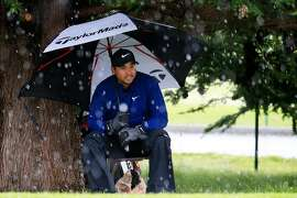 PEBBLE BEACH, CALIFORNIA - FEBRUARY 10:  Jason Day of Australia takes cover under an umbrella during a hail storm during the final round of the AT&T Pebble Beach Pro-Am at Pebble Beach Golf Links on February 10, 2019 in Pebble Beach, California. (Photo by Chris Trotman/Getty Images)