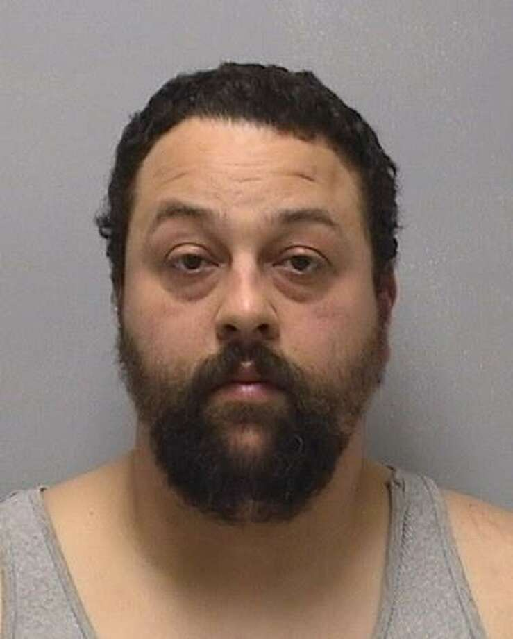 John E. Kouremetis, 38, of Branford was arrested Feb. 2, 2019 by the Orange Police Department on multiple charges after allegedly throwing beer bottles out of his car. Photo: Contributed / Orange Police Department