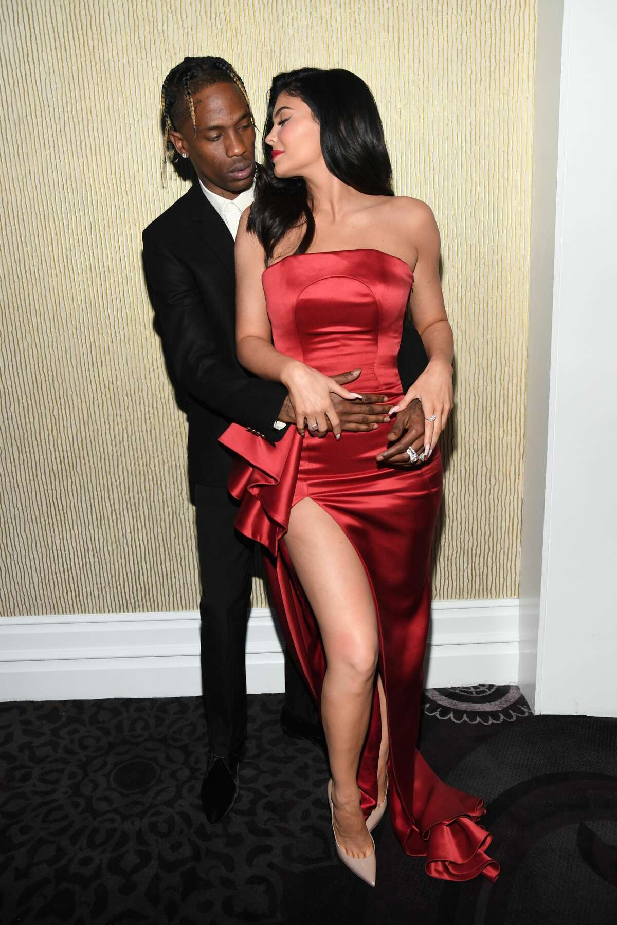 BEVERLY HILLS, CA - FEBRUARY 09: Travis Scott (L) and Kylie Jenner pose during the Pre-GRAMMY Gala and GRAMMY Salute to Industry Icons Honoring Clarence Avant at The Beverly Hilton Hotel on February 9, 2019 in Beverly Hills, California. (Photo by Kevin Mazur/Getty Images for The Recording Academy)