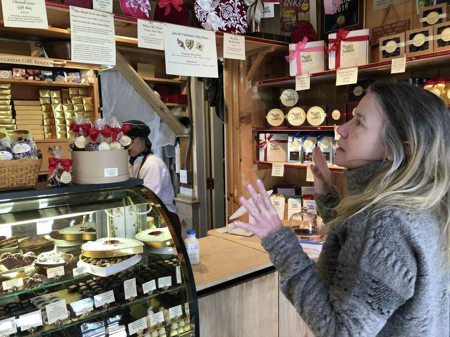 Aniela Salamacha of Colebrook chooses chocolates for a custom box of her favorite flavors. Photo: Leslie Hutchison / Hearst Connecticut Media