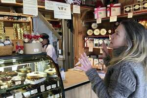 Aniela Salamacha of Colebrook chooses chocolates for a custom box of her favorite flavors.