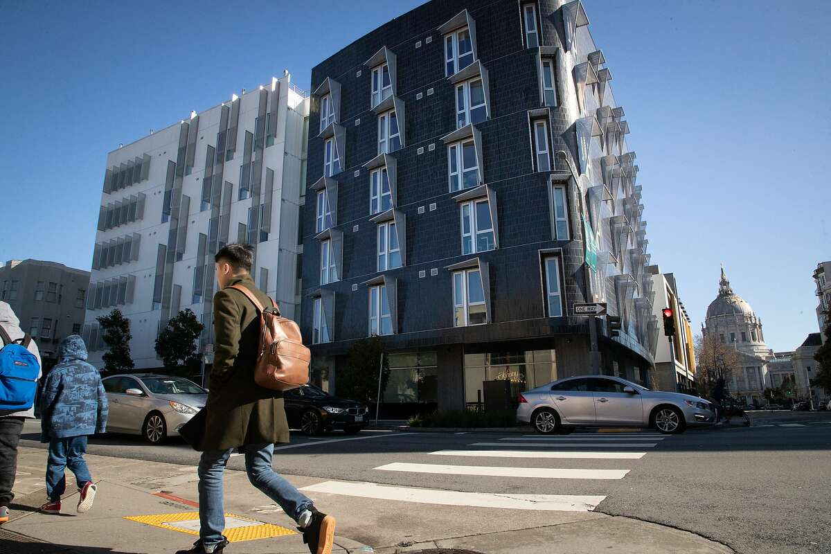 Resident Emmanuel Lalande says 388 Fulton, is an example on a housing proposed close to transit centers. Pedestrians walk past the 5-year old building on Saturday, Feb. 9, 2019, in San Francisco, CA.