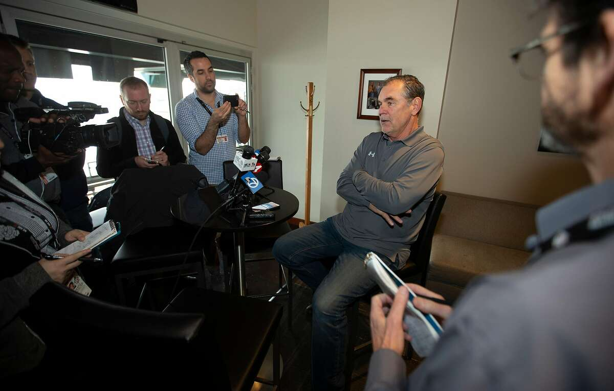 Manager Bruce Bochy, right, conducts a press conference with reporters at the San Francisco Giants media day, on Friday, Feb. 8, 2019 in San Francisco, Calif.