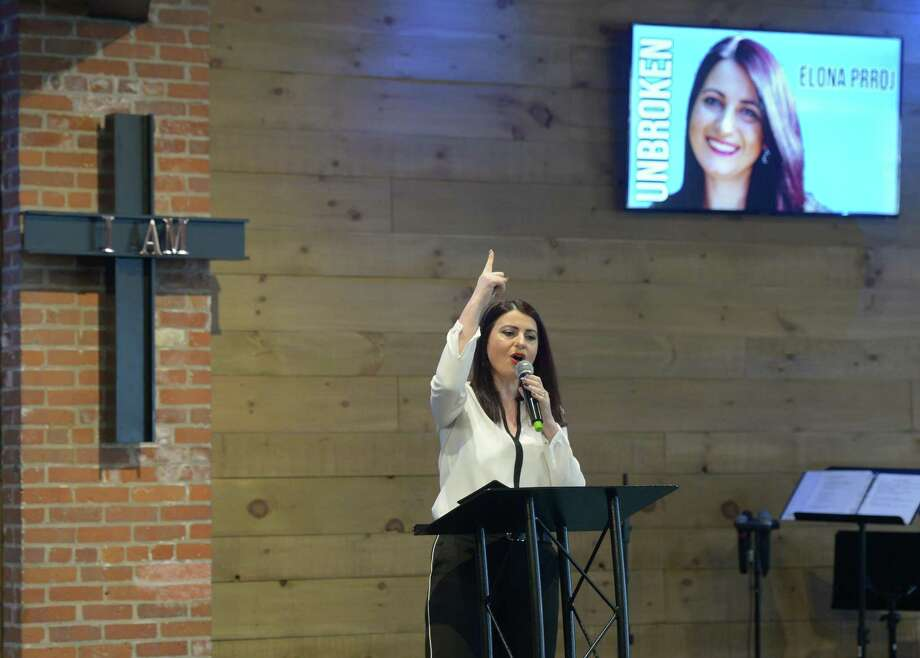 Guest speaker Elona Prroj speaks about the importance of faith and forgiveness at Word Alive Bible Church in Norwalk on Sunday. Prroj's husband Tani was murdered in 2010 because of a blood feud with another family. A week before his death, Tani told his brother that if he was killed because of the feud that he wished to forgive the family and not continue the cycle of vengeance. Photo: Tyler Sizemore / Hearst Connecticut Media / Greenwich Time