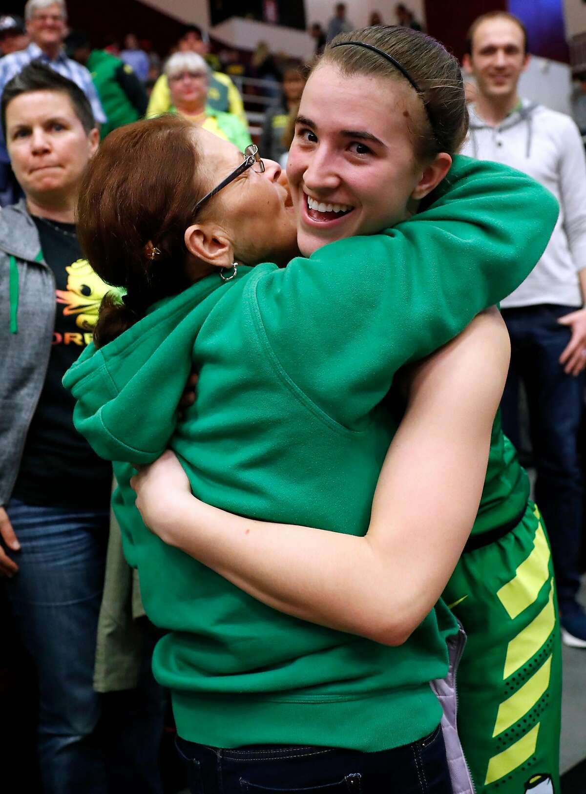 Oregon's Sabrina Ionescu gets a hug after the Ducks' 88-48 win over Stanford during Pac 12 Women's basketball game at Maples Pavilion in Stanford, Calif., on Sunday, February 10, 2019.