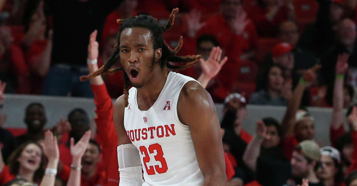 Houston Cougars forward Cedrick Alley Jr. (23) celebrates his three point basket against the Cincinnati Bearcats during the first half of the American Athletic Conference game at Fertitta Center on Sunday, Feb. 10, 2019, in Houston.