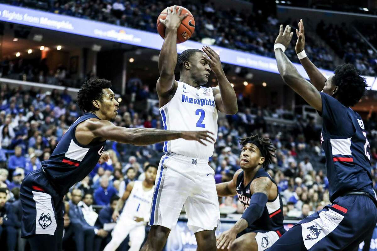 Memphis' Alex Lomax passes the ball during Sunday's game against UConn.