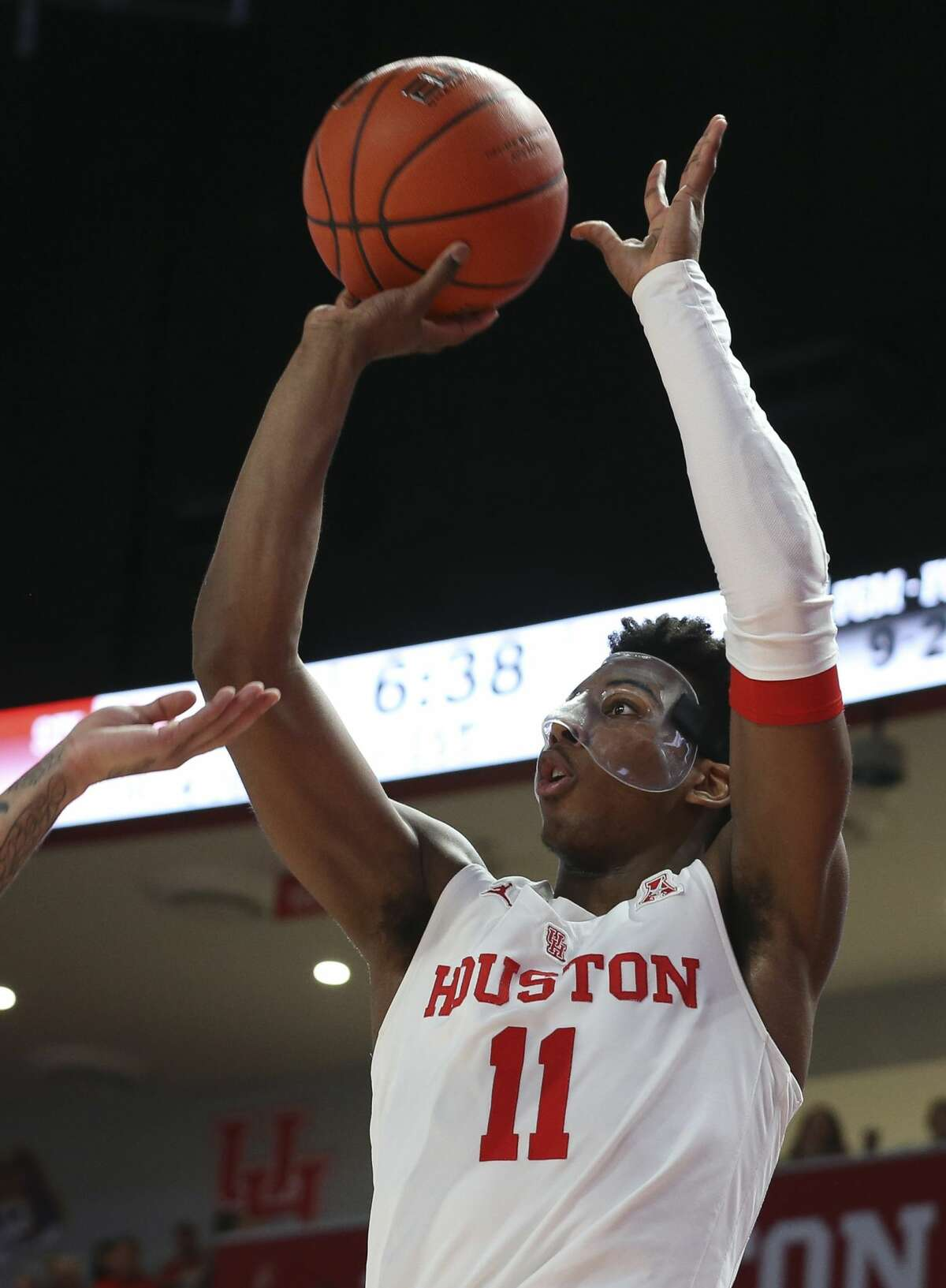 Houston Cougars guard Nate Hinton (11) aims for a three point basket during the first half of the American Athletic Conference game against the Cincinnati Bearcats at Fertitta Center on Sunday, Feb. 10, 2019, in Houston.