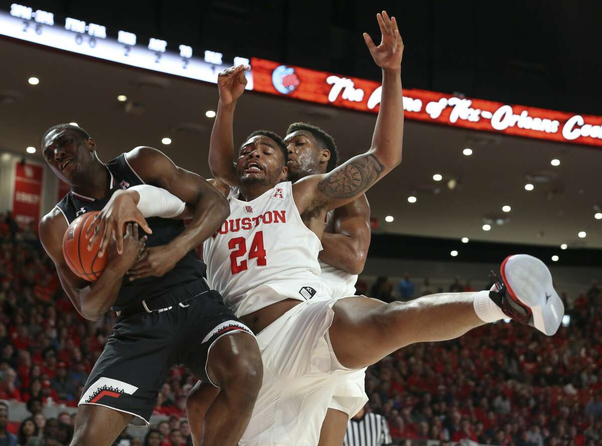 Houston Cougars forward Breaon Brady (24) battles for a rebound with Cincinnati Bearcats guard Keith Williams (2) during the first half of the American Athletic Conference game at Fertitta Center on Sunday, Feb. 10, 2019, in Houston.