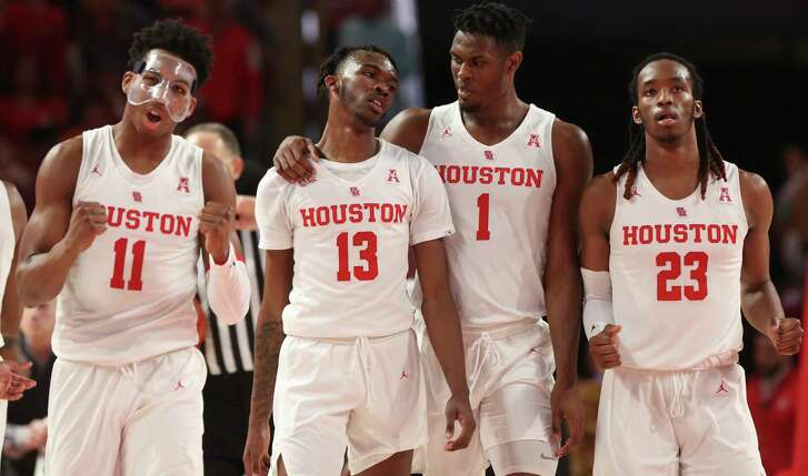 Houston Cougars players Nate Hinton (11), Dejon Jarreau (13), Chris Harris Jr. (2) and Cedrick Alley Jr. (23) are pumped as they are securing the lead against the Cincinnati Bearcats during the second half of the American Athletic Conference game at Fertitta Center on Sunday, Feb. 10, 2019, in Houston. The Houston Cougars defeated the Cincinnati Bearcats 65-58.