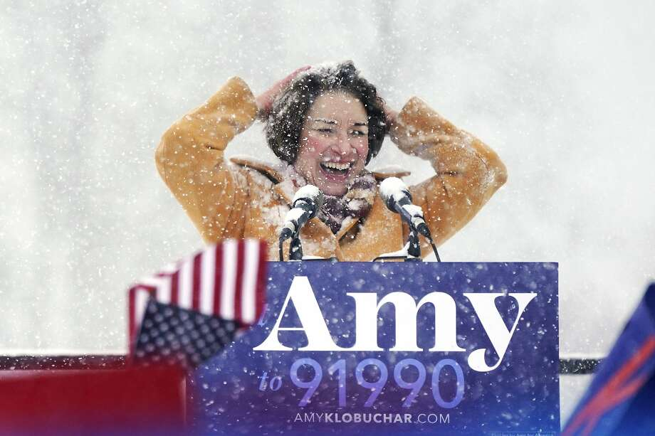 U.S. Sen. Amy Klobuchar wipes snow from her hair after announcing she is running for president of the United States, at Boom Island Park, Sunday, Feb. 10, 2019, in Minneapolis. Klobuchar joined the growing group of Democrats jostling to be president and positioned herself as the most prominent Midwestern candidate in the field, as her party tries to win back voters in a region that helped put Donald Trump in the White House. (Anthony Souffle/Star Tribune via AP) Photo: Anthony Souffle, Associated Press