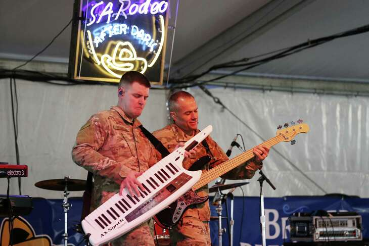 "U.S. Air Force Band of the West rock band, ""Top Flight,"" members Staff Sgt. Cody Peterson, left, and Master Sgt. Mark Frandsen perform Sunday in the food court pavilion at the San Antonio Stock Show & Rodeo."