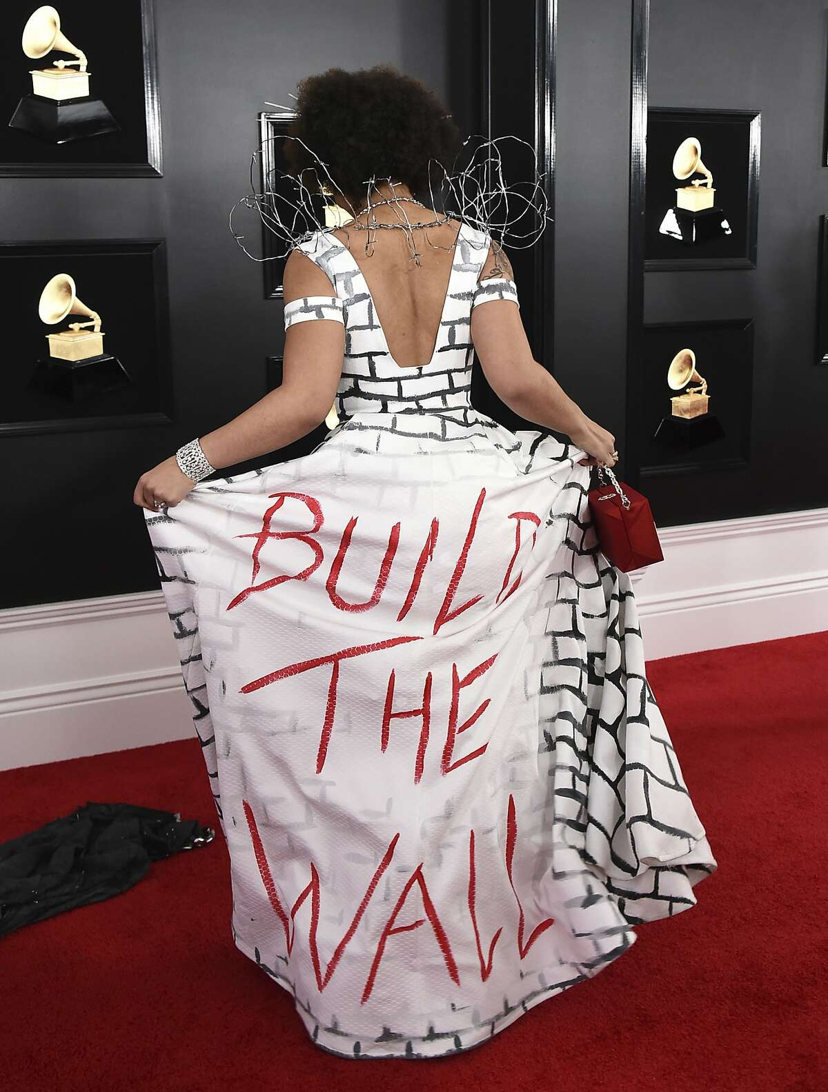 """Joy Villa arrives at the 61st annual Grammy Awards at the Staples Center wearing a dress that reads """"Build the Wall"""" on Sunday, Feb. 10, 2019, in Los Angeles."""