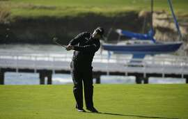 Phil Mickelson follows his approach shot from the fourth fairway of the Pebble Beach Golf Links during the final round of the AT&T Pebble Beach Pro-Am golf tournament Sunday, Feb. 10, 2019, in Pebble Beach, Calif. (AP Photo/Eric Risberg)