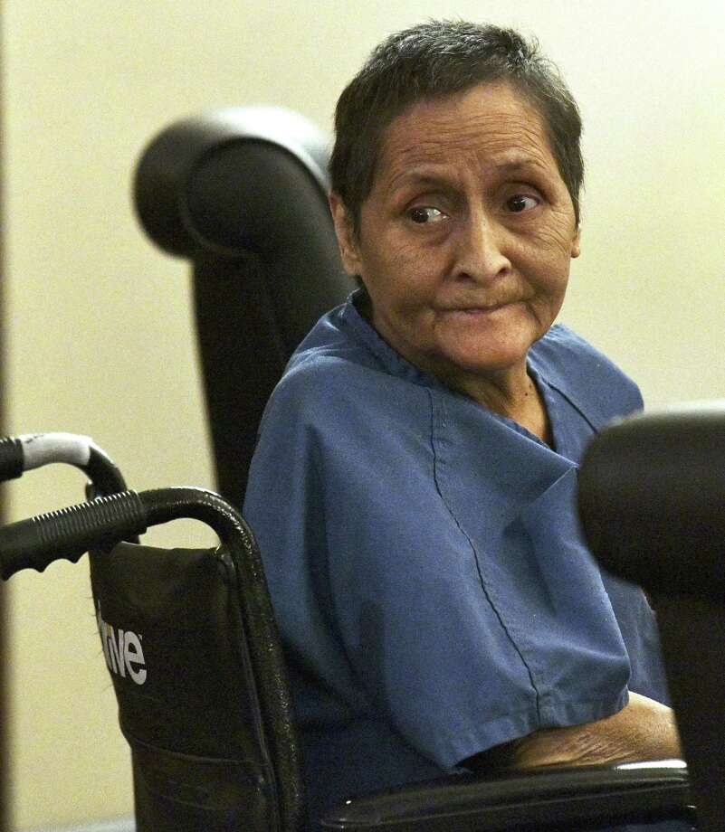 Beatrice Sampayo, 64, who is accused of helping cover up the death of her 8-month-old grandson, King Jay Davila, listens during a Friday hearing at which her bail was reduced from $250,000 to $50,000 by Judge Andrew Carruthers. Photo: Billy Calzada /Staff Photographer / San Antonio Express-News