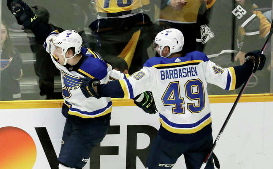 The Blues' Vladimir Tarasenko (left) celebrates with Ivan Barbashev after Tarasenko scored the winning goal in overtime against the Predators on Sunday in Nashville, Tenn. Photo: Associated Press