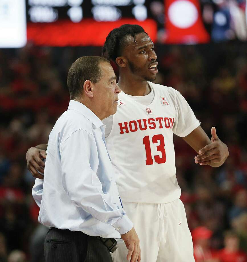 Houston's Dejon Jarreau (13) talks with head coach Kelvin Sampson during a recent game. Photo: Bob Levey / Getty Images / 2019 Getty Images