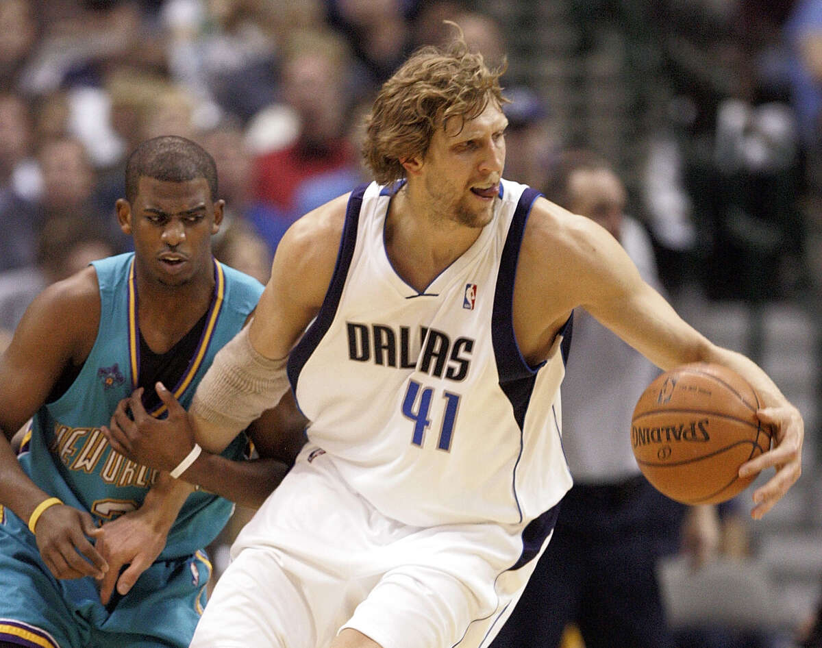 DALLAS - APRIL 25: Dirk Nowitzki #41 of the Dallas Mavericks handles the ball against Chris Paul #3 of the New Orleans Hornets in Game Three of the Western Conference Quarterfinals during the 2008 NBA Playoffs at the American Airlines Center on April 25, 2008 in Dallas, Texas. (Photo by Layne Murdoch/Getty Images)
