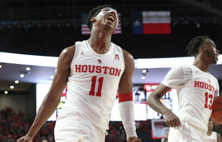 UH's Nate Hinton (11) and DeJon Jarreau celebrate the Cougars' 32nd consecutive home victory, the nation's longest active streak. Photo: Yi-Chin Lee,  Staff / Houston Chronicle / © 2019 Houston Chronicle