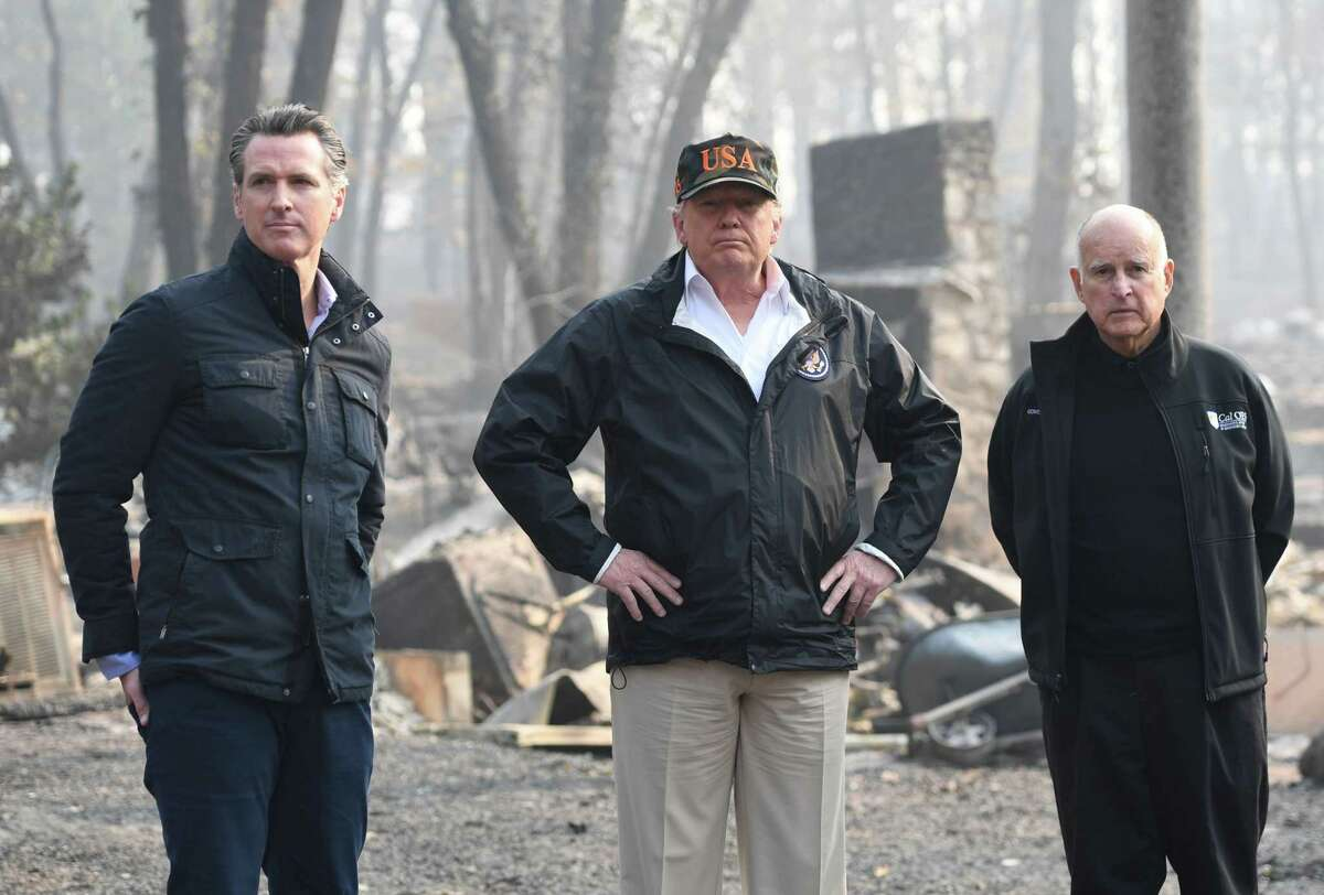 Current Gov. Gavin Newsom (left), President Trump and then-Gov. Jerry Brown view fire damage in Butte County last year.