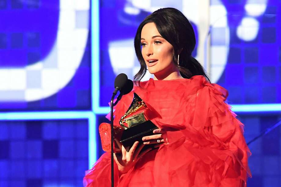 "Kacey Musgraves accepts the award for Album Of The Year for ""Golden Hour"" onstage during the 61st Annual Grammy Awards on February 10, 2019, in Los Angeles. Photo: Robyn Beck, AFP/Getty Images"