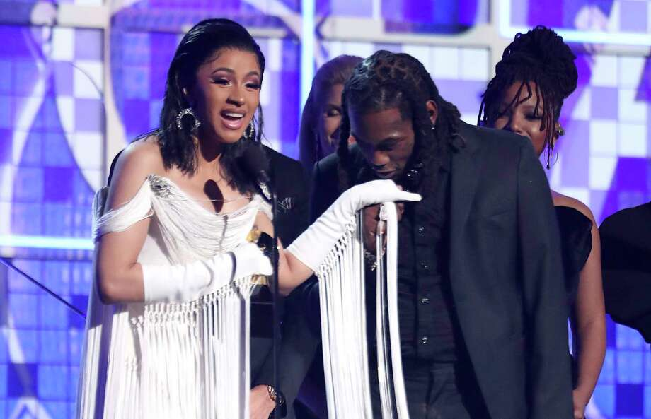 "Cardi B, left, accepts the award for best rap album for ""Invasion of Privacy"" as Offset kisses her hand at the 61st annual Grammy Awards on Sunday, Feb. 10, 2019, in Los Angeles. (Photo by Matt Sayles/Invision/AP) Photo: Matt Sayles / Invision"