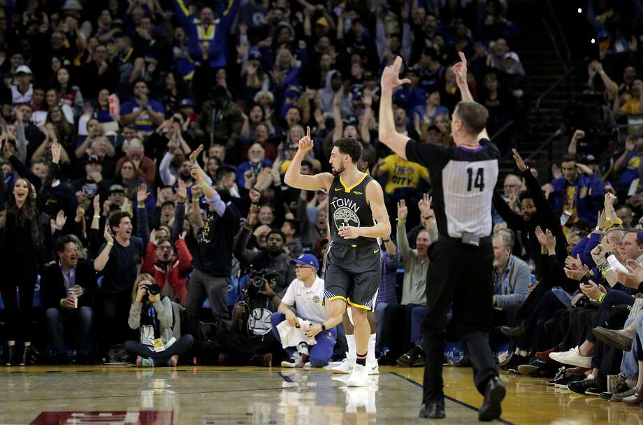 Klay Thompson (11) gestures after hitting a three pointer in the second half as the Golden State Warriors played the Miami Heat at Oracle Arena in Oakland, Calif., on Sunday, February 10, 2019. Photo: Photos By Carlos Avila Gonzalez / The Chronicle